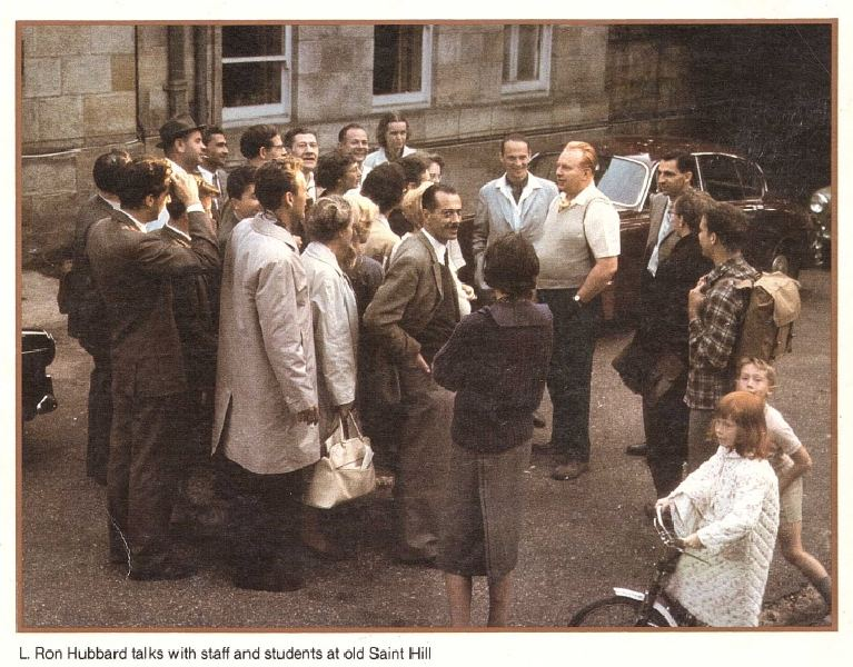 Peter Gillham (in a gray jacket, standing behind LRH) and Peter Jr. (behind Suzette) at Saint Hill in 1962